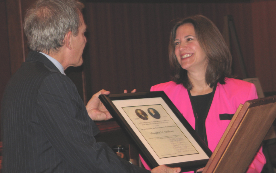 Supreme Judicial Court Justice Francis X. Spina presents Margaret M. Pinkham with the Adams Pro Bono Award